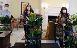 Staff with donated flowers